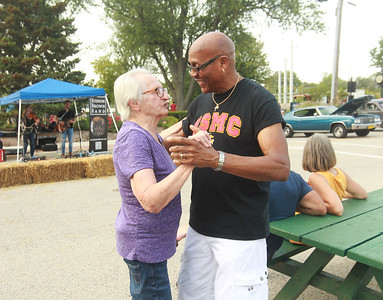 Candace H. Johnson-for Shaw Media Stella Minkalis, of Round Lake dances with Richard Hill, of Mundelein, with Dress Up & Dance on the Move, a mobile dance group, to music by the Judson Brown Band during the Celebration of Fall event on Cedar Avenue in Lake Villa.  (9/11/21)