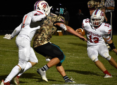 Ottawa's Ryder Miller runs the ball against Woodstock North during their game at Woodstock North High School on Friday, Sept. 24, 2021 in Woodstock.