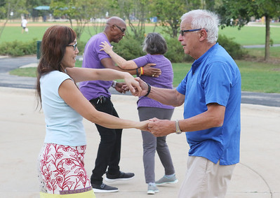Candace H. Johnson-for Shaw Media Alison Hendriks, of Gurnee dances with Tony Minorini, of Deerfield during Dancing in the Park with the Dress Up & Dance! On the Move mobile dance organization at Townline Community Park in Lake Forest. Music was played for Ballroom and Latin dancing.  (9/26/21)