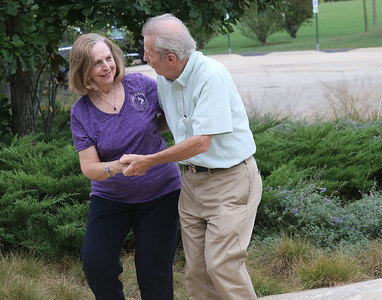Candace H. Johnson-for Shaw Media Anita Dolan and her partner, Dennis Majkowski, both of Lindenhurst enjoy dancing together during Dancing in the Park with the Dress Up & Dance! On the Move mobile dance organization at Townline Community Park in Lake Forest. Music was played for Ballroom and Latin dancing.  (9/26/21)