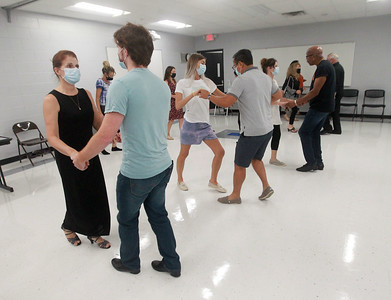 Candace H. Johnson-for Shaw Media Pam Yadanza, of Lake Villa and her son, Zach, 22, practice basic dance steps with other dancers during the Latin Social Dance Class at the College of Lake County in Grayslake. Angela and Richard Hill, with the Dress Up & Dance! On the Move mobile dance organization, were instructors for the class.  (9/27/21)