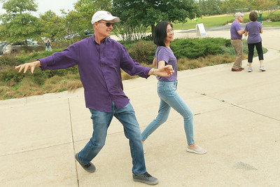 Candace H. Johnson-for Shaw Media Bob McHugh, of Lake Barrington and Francis Lei, of Vernon Hills dance together during Dancing in the Park with the Dress Up & Dance! On the Move mobile dance organization at Townline Community Park in Lake Forest. Music was played for Ballroom and Latin dancing.   (9/26/21)