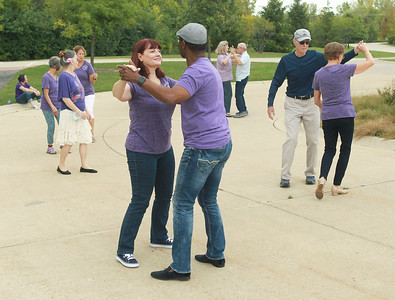 Candace H. Johnson-for Shaw Media Jennifer and Rene Degla, of Island Lake dance together during Dancing in the Park with the Dress Up & Dance! On the Move mobile dance organization at Townline Community Park in Lake Forest. Music was played for Ballroom and Latin dancing.   (9/26/21)