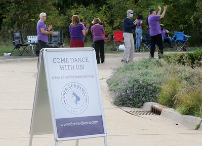 Candace H. Johnson-for Shaw Media Several dancers enjoy line dancing during Dancing in the Park with the  Dress Up & Dance! On the Move mobile dance organization at Townline Community Park in Lake Forest.  (9/26/21)