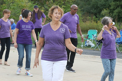Candace H. Johnson-for Shaw Media Susan Moore, of Antioch (center) does some line dancing with other dancers during Dancing in the Park with the Dress Up & Dance! On the Move mobile dance organization at Townline Community Park in Lake Forest.  Music was also played for Ballroom and Latin dancing. (9/26/21)