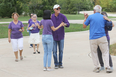 Candace H. Johnson-for Shaw Media Bob McHugh, of Lake Barrington and Francis Lei, of Vernon Hills (center) enjoy talking with other dancers as they dance together during Dancing in the Park with the Dress Up & Dance! On the Move mobile dance organization at Townline Community Park in Lake Forest. Music was played for Ballroom and Latin dancing. Single dancers also enjoyed line dancing. (9/26/21)