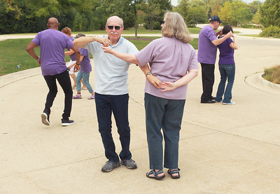 Candace H. Johnson-for Shaw Media John and Diane Zitkus, of Mundelein dance together during Dancing in the Park with the Dress Up & Dance! On the Move mobile dance organization at Townline Community Park in Lake Forest.  The couple have been married for forty-seven years. Music was played for Ballroom and Latin dancing. (9/26/21)