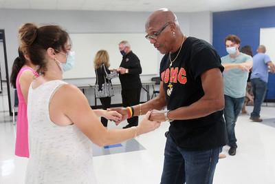Candace H. Johnson-for Shaw Media Amy Kaylor, of Lindenhurst learns some basic steps from Richard Hill, instructor, during the Latin Social Dance class at the College of Lake County in Grayslake. Hill is co-owner of the Dress-Up & Dance! On the Move mobile dance organization. (9/27/21)