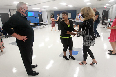 Candace H. Johnson-for Shaw Media Bob Mack, of Lake Zurich gets some instruction on basic dance steps from Angela Hill, instructor, as she works with his partner, Roni Leavitt, of Vernon Hills during the Latin Social Dance Class at the College of Lake County in Grayslake. Hill owns the Dress Up & Dance! On the Move mobile dance organization.  (9/27/21)