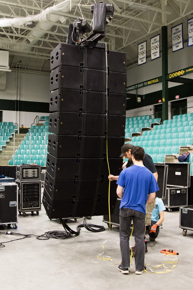 Atomic Audio helping CUB members install speaker stacks to hang from the ceiling. Each stack costs in the range of $100,000.