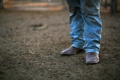 Dominic Beyer's boots in the feedlot of his family's farm on Saturday, Nov. 2, 2019 in Sidney, NE.