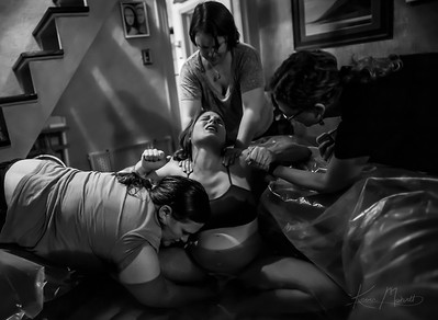 DENVER - Twelve hours after Lindsey Frank's first contractions, the pain becomes unbearable.  She is at home surrounded by two midwives and a doula who support her through the pain.  Frank will not have any access to painkillers while attempting a homebirth.  A birthing tub is used to help soothe the pain.  This image is part of a story on natural birthing choices for women who have experienced unwanted cesarean operations.