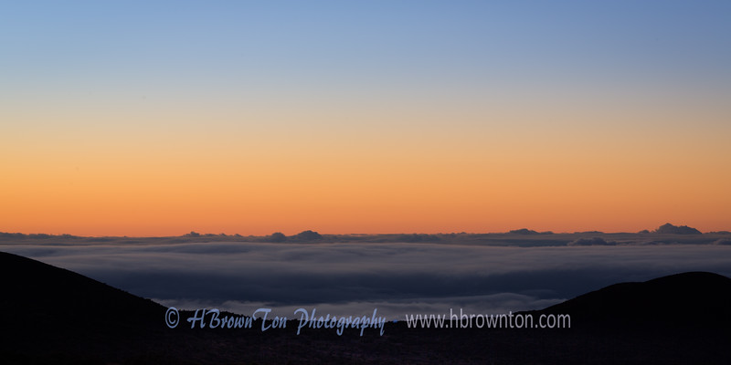 Pre-dawn Glow Above the Clouds
