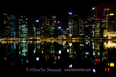 It was around mid-night -- the Marina Bay was calm enough to take this reflective shot fo the Singapore skyline