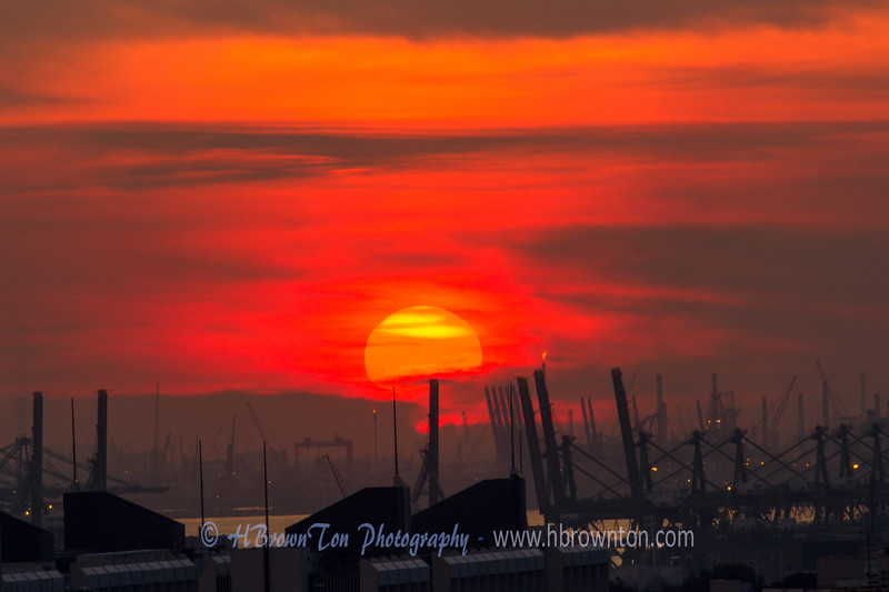 The sunset quickly turned a deep red before dissapearing into the evening -- the cranes are part of the massive  Pasir Panjang Shipping Terminal