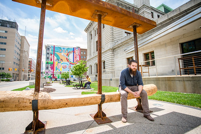 Skylar Sparks (BFA Sculpture and Functional Art) with his Garden Bench