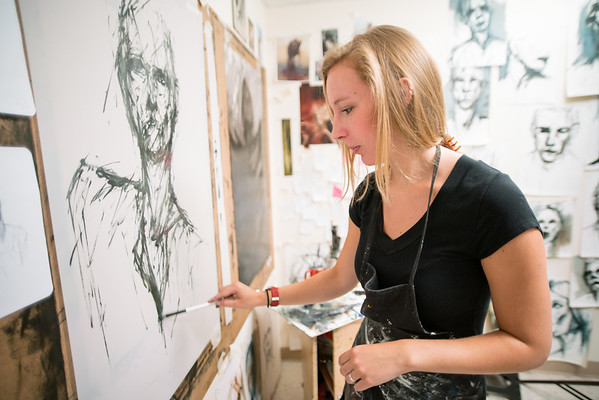 Anna Schierbeek ('16 BFA Painting) working in her studio
