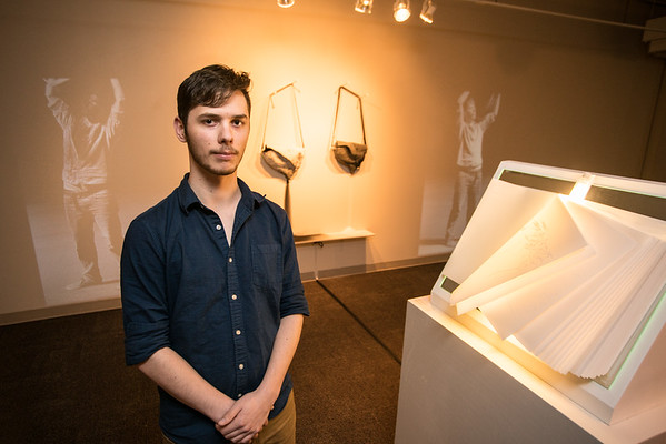Eric Tracy ('17 BFA Printmaking) with his work Introspection