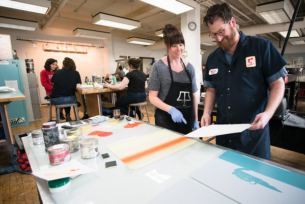 Printmaking Assistant Professor Olivia Timmons working with Sean Allen (BFA Furniture Design)