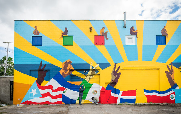 (right to left): Graphic Design student David Frison IV and KCAD alumnus Ricardo Gonzalez ('16, MFA Painting) finishing up the mural.