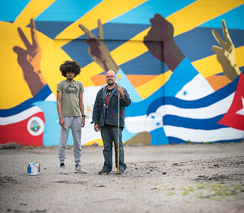 (left to right): Graphic Design student David Frison IV and KCAD alumnus Ricardo Gonzalez ('16, MFA Painting) along with Drawing student Raquel Silva worked spring 2016 on a mural with a group of local teens. The KCAD students and alumnus worked with the Cook Arts Center and the Hispanic Center of West Michigan to help the teens design and complete the large project at 912 Grandville Avenue which promotes unity, identity, and respect in the neighborhood.