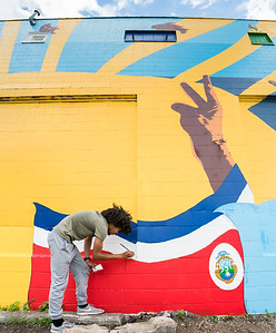 Graphic Design student David Frison IV finishing up the mural.