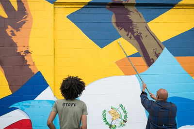 (left to right): Graphic Design student David Frison IV and KCAD alumnus Ricardo Gonzalez ('16, MFA Painting) finishing up the mural.