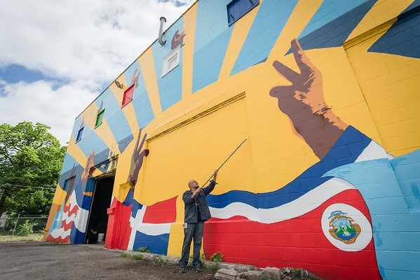 KCAD alumnus Ricardo Gonzalez ('16, MFA Painting) finishing up the mural.