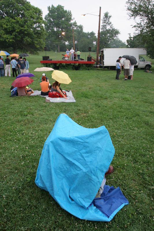 taking shelter from the rain which started as The Antiques were finishing their set at Fort Reno