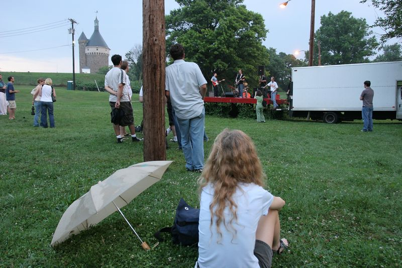 Fort Reno's turret looms in the background while the weather cooperates just in time to allow The Sprites to play