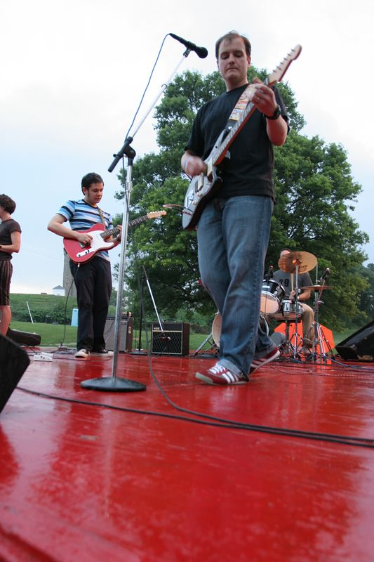 The Sprites perform an abbreviated set on the wet stage