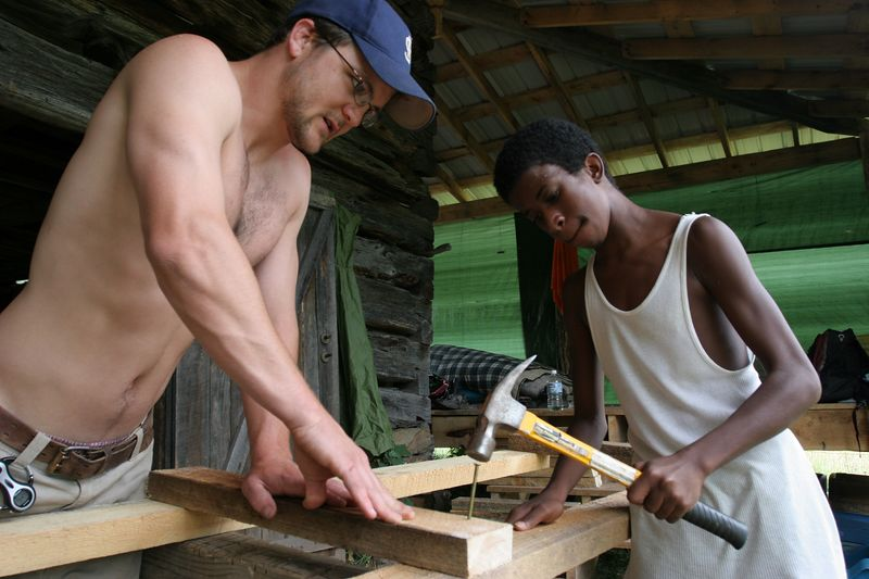 ben and forman work on another part of the chicken coop