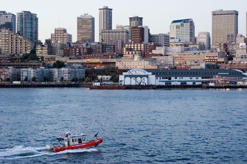 ferries are escorted into Seattle by heavily armed Coastguard boats