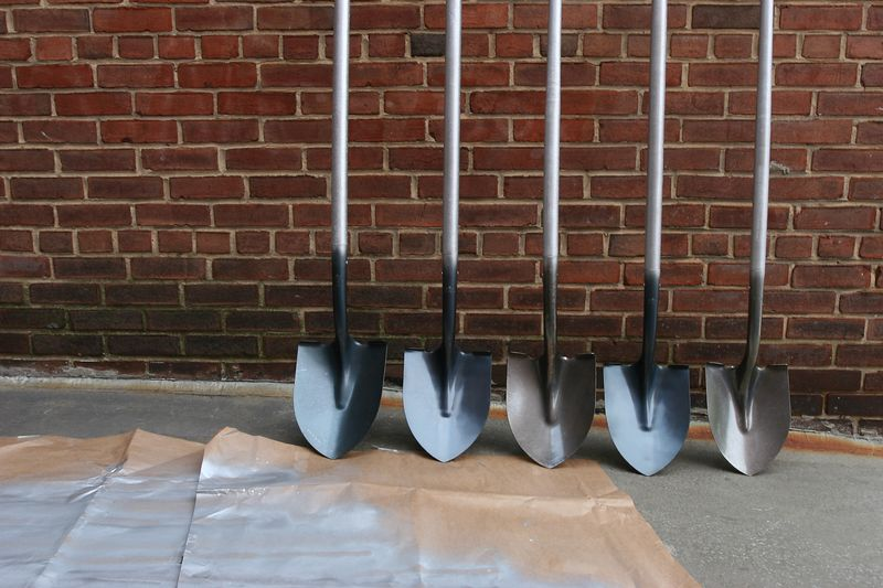 spray-painting shovels silver