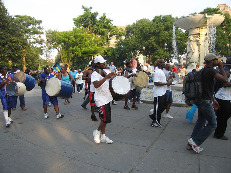 marching band from the Bahamas practices around Dupont Circle for the DC Caribbean Carnival