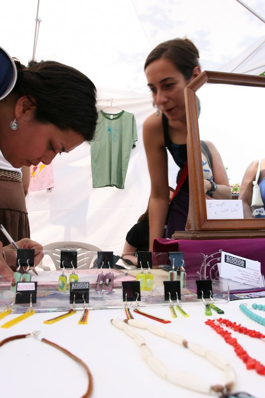 kristina sells her designer jewelry and clothing in one of the tented stalls