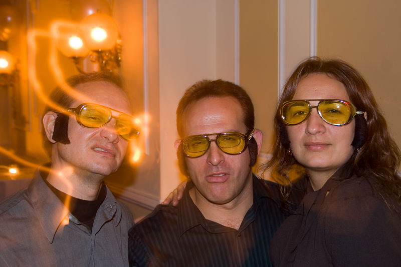 Kurt, Marc and Jeanette - Elvis glasses (with sideburns) were passed around the guests in honour of the fact that Leigh and I were married in Las Vegas 10 years ago.
