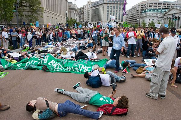 anti-war protesters stage a die-in on Pennsylvania Avenue in front of the White House, Washington DC