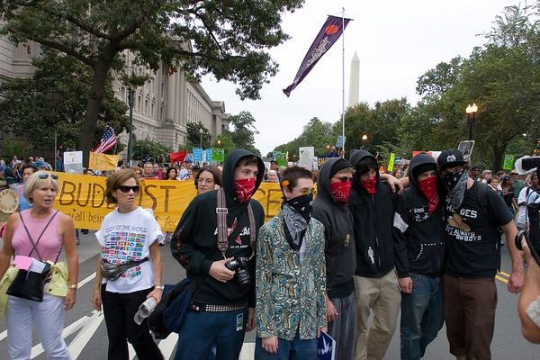 anarchists pose for photographer with Bhuddist peace delegation behind, anti-war protest, Washington DC