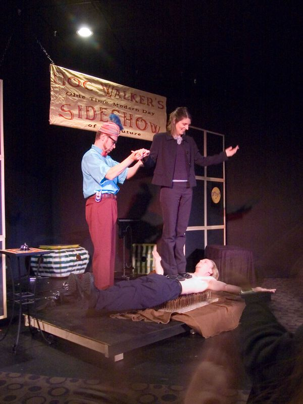 Lisa also tries not to kill Damien Blade, The Most Dangerous Man In The World as she stand atop him as he lies on a rusty bed of nails (with balancing help from Swami Yomahmi).