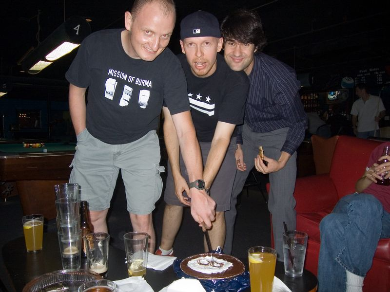 stefan, james and greg cut leigh's yummy 8-ball cake!