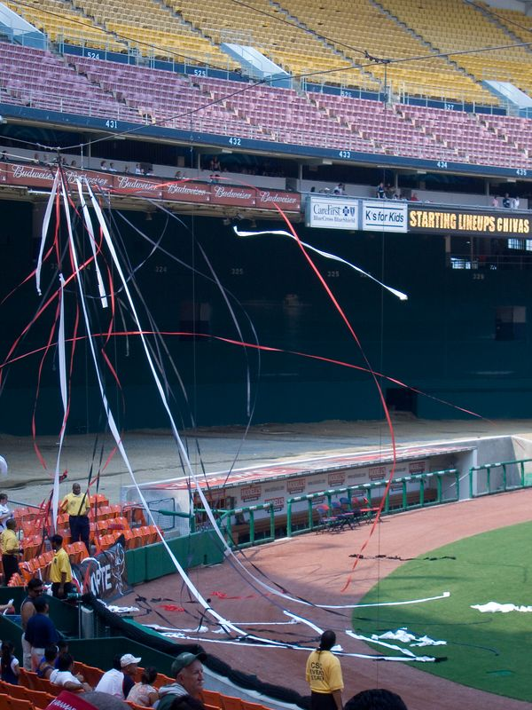 those boisterous El Norte/Northside fans put the baseball backstop wires to good use