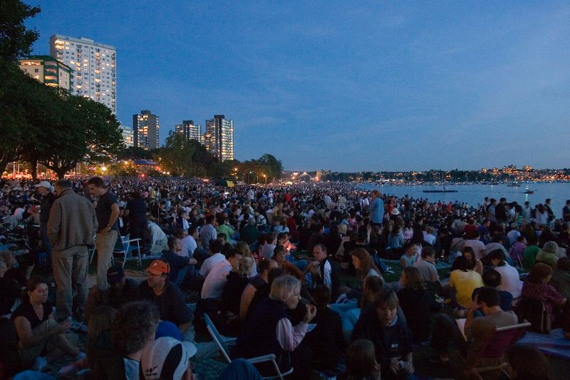 crowds gather on English Bay beach in downtown Vancouver for the annual, international fireworks competition