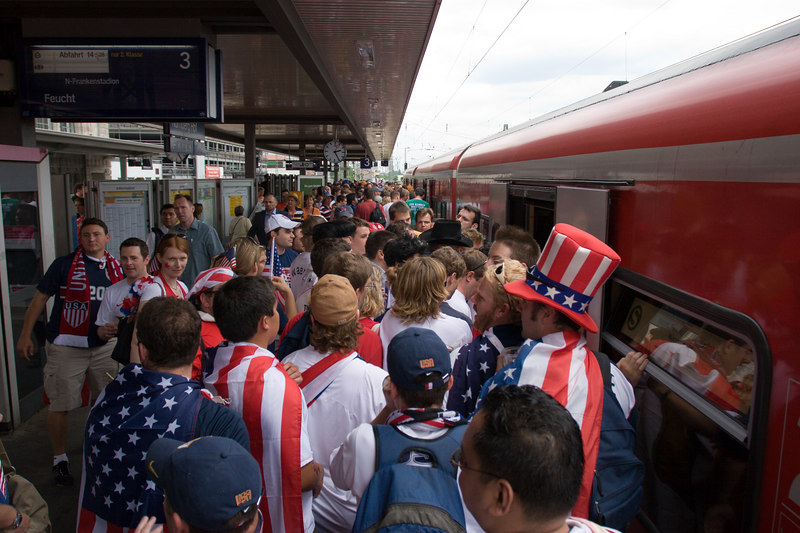 USA fans board the tram to the stadium in Nürnberg for the match with Ghana.
