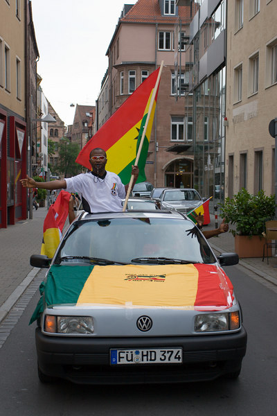 Ghana fans celebrate victory while driving through the streets of Nürnberg.