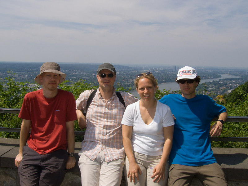 "James, Erwin, Yvonne and Alexi atop <a href=""http://en.wikipedia.org/wiki/Drachenfels_%28Siebengebirge%29"" target=""blank"">Drachenfels mountain</a> with a view of the Rhine river, Bonn and even Köln way off in the distance."