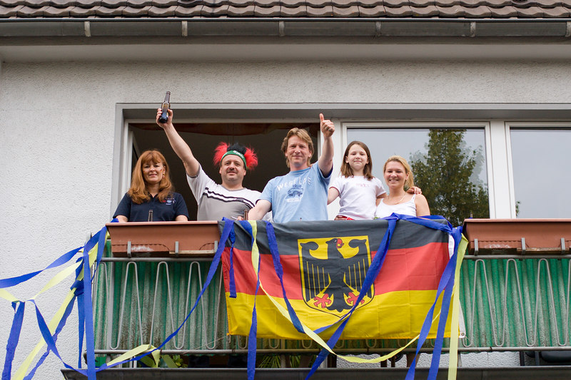 Köln residents living on the main road to the stadium.  Germany had beaten Ecuador earlier that day and now they were toasting England and Sweden fans heading to the stadium for their game.