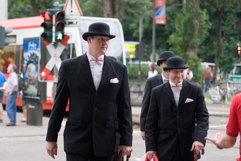 Emgland fans in bowler hats and St. George's bowties arrive at the stadium by tram for the game with Sweden in Köln.