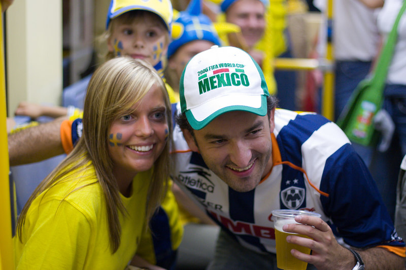 Sweden and Mexico fans pose for pictures on the tram back from the stadium in Köln after Sweden's 2-2 draw with England.