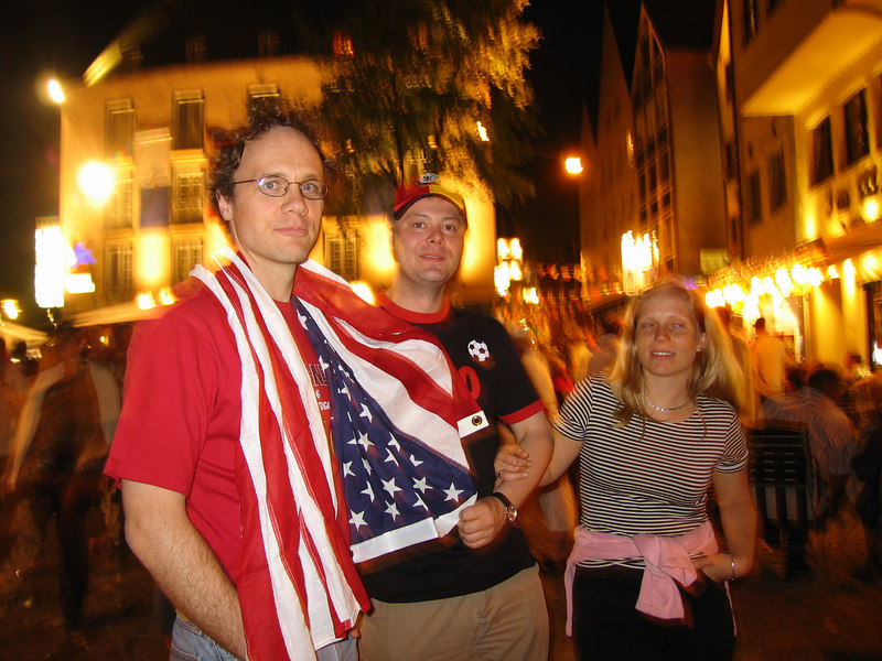 Alexi, Erwin and Yvonne celebrate the USA's survival after drawing with Italy.